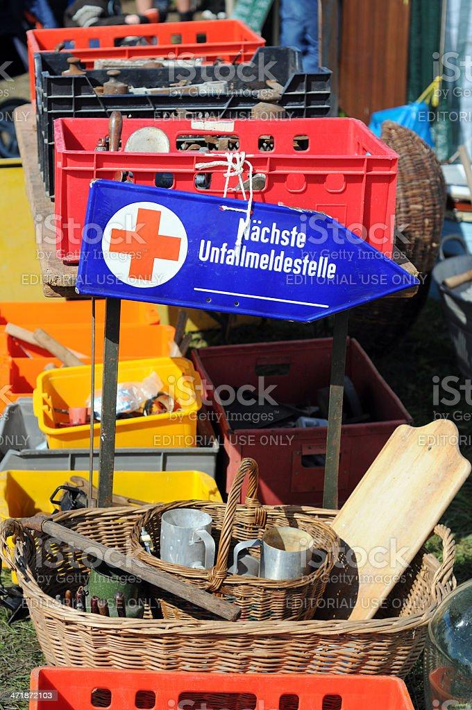 Flea Market with antique ambulance information sign - Flohmarkt stock photo