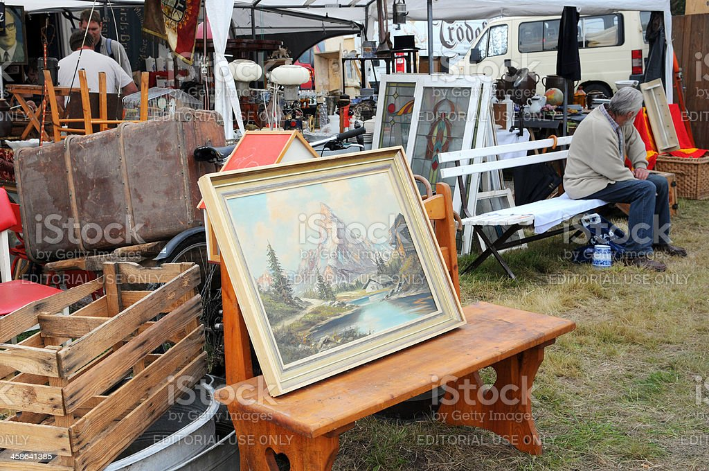 Flea Market with landscape image visitors in background stock photo