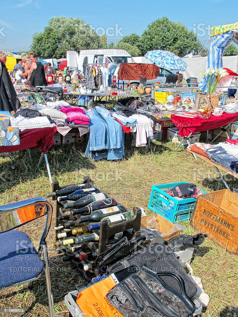 flea market with wine bottles and cloth stock photo