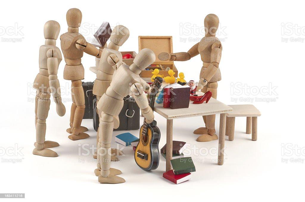 Flea market - wooden mannequin dealing goods royalty-free stock photo