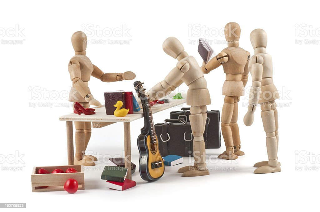 Flea market - wooden mannequin dealing goods stock photo