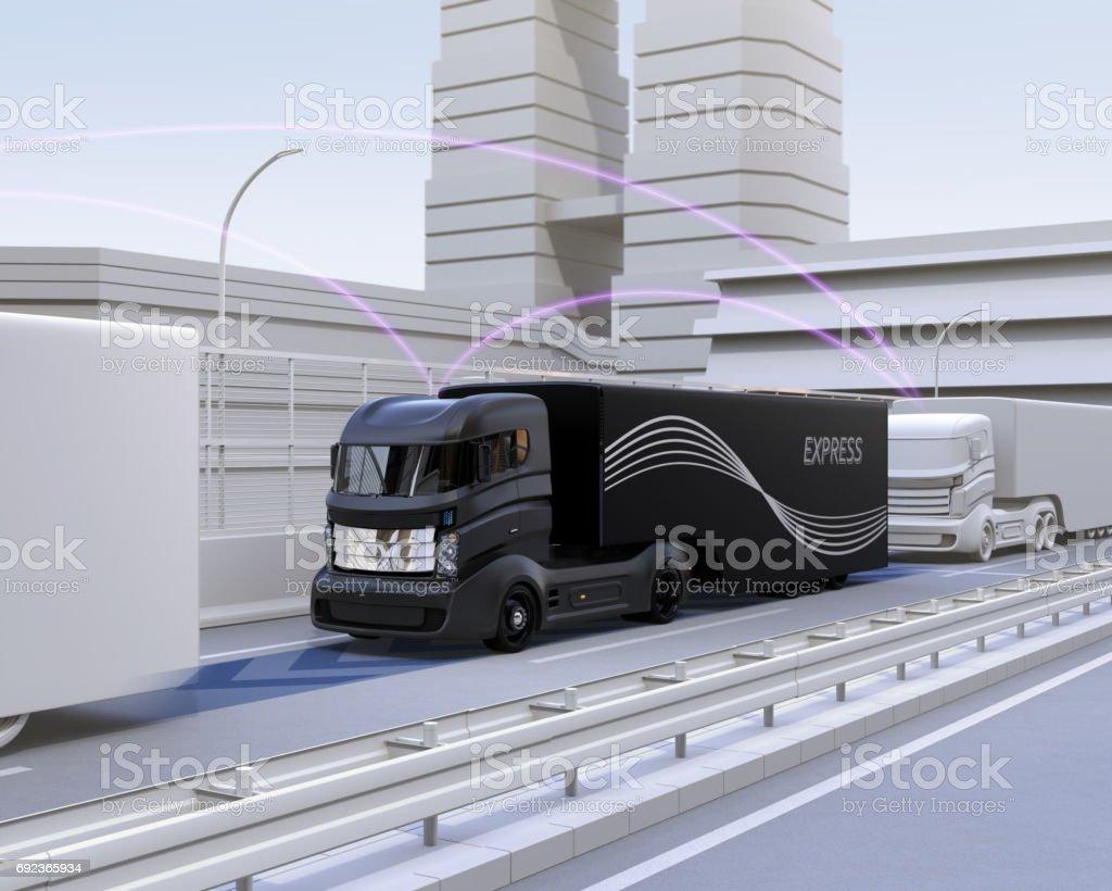 A fleet of autonomous truck driving on highway stock photo