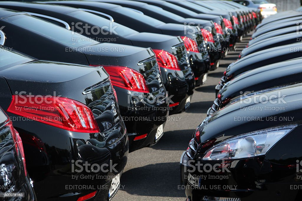 Fleet of cars in a row stock photo