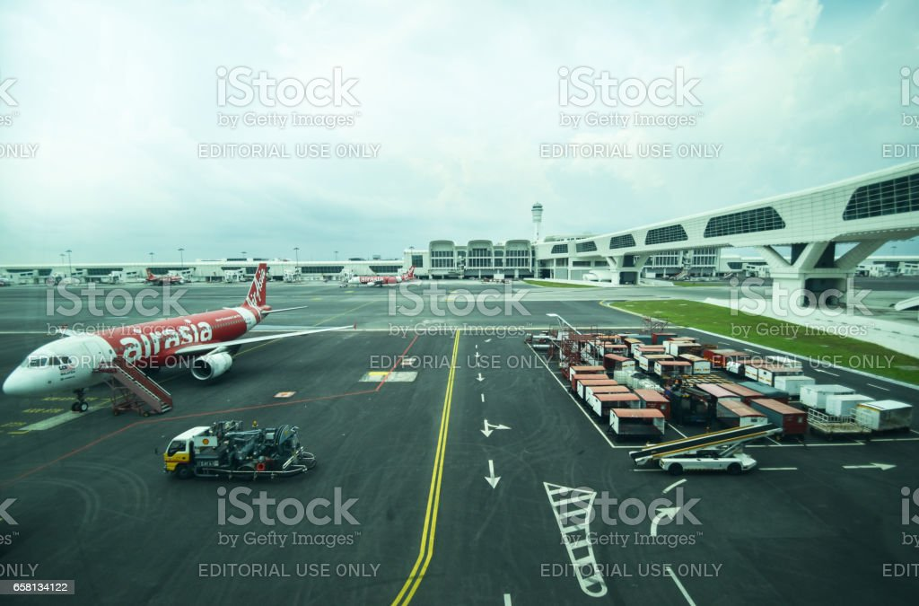 A fleet of commercial aircrafts being serviced at the terminal of KLIA2 international airport Malaysia. stock photo