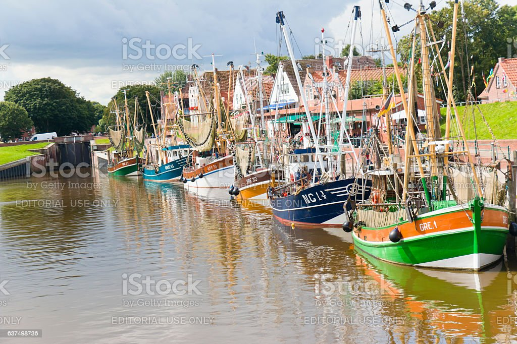 Fleet of fishing boats and shrimp boats at the harbor of Greetsiel stock photo