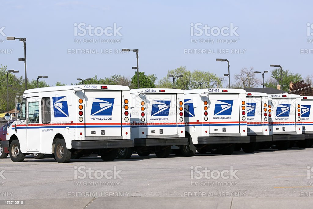 Fleet of USPS mail delivery trucks stock photo