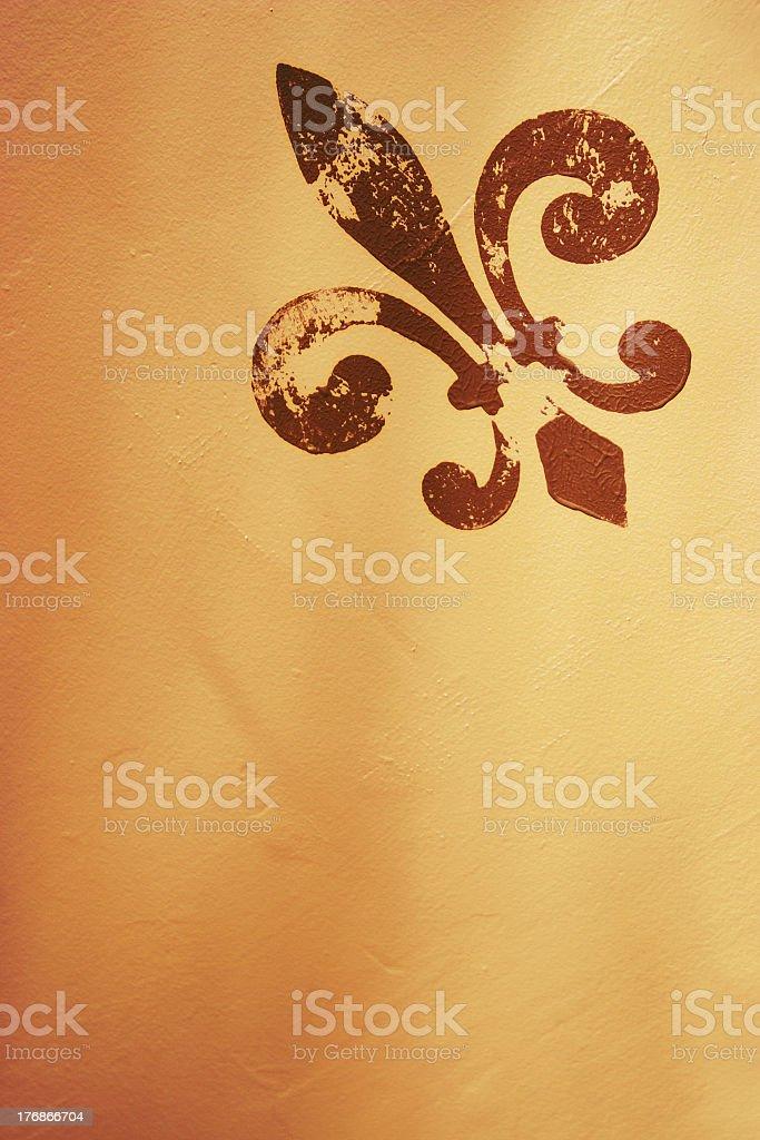 A Fleur de lis on a tan background stock photo