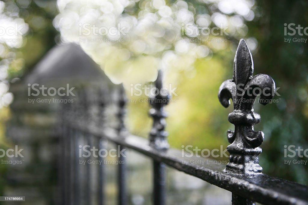 Fleur de Lys fence stock photo