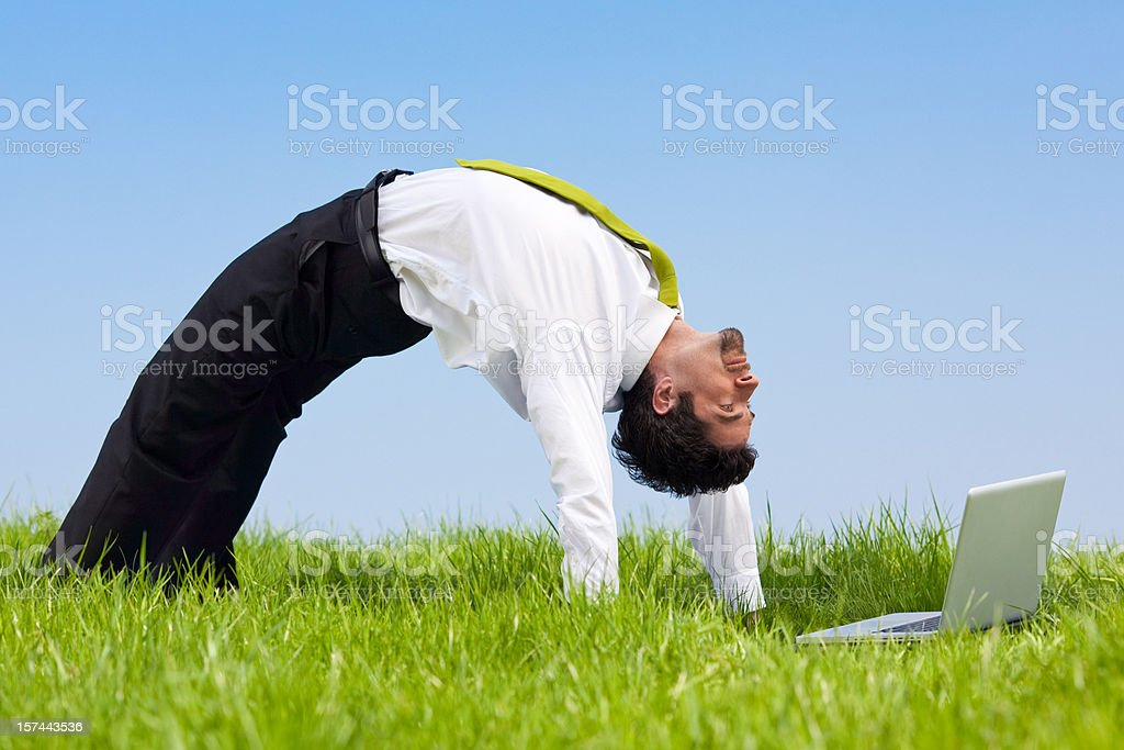 flexible business manager outdoor job bending over backwards wit royalty-free stock photo