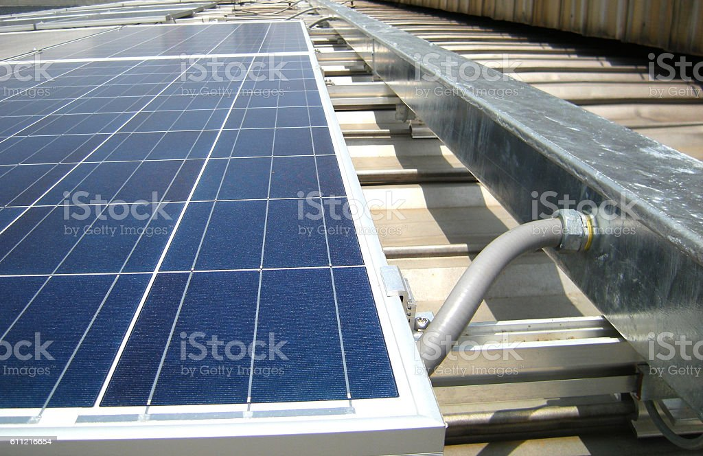 Flexible Conduit connected to Wireway Solar PV Rooftop stock photo