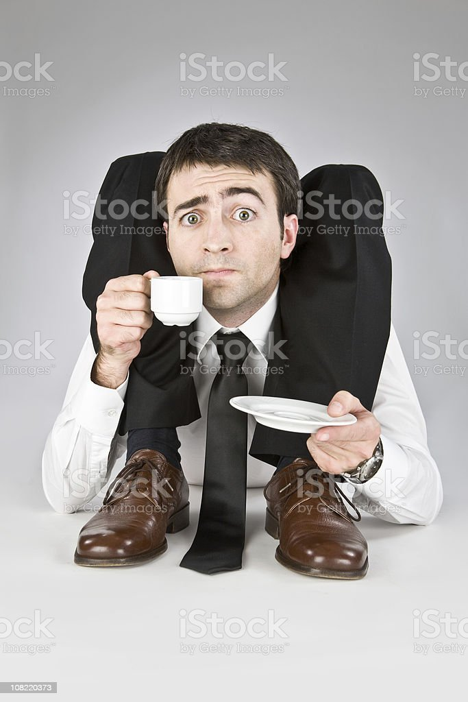 flexible contortion business manager drinking coffee stock photo