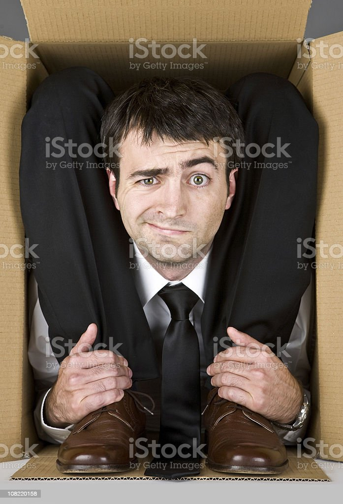 flexible contortion business manager in box stock photo