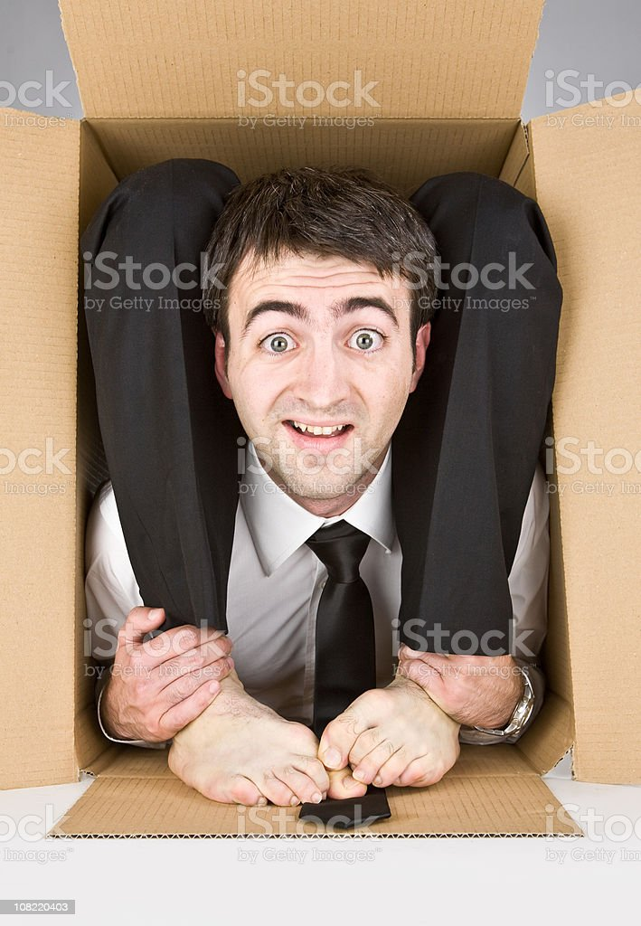 flexible contortion business manager in box ready to travel stock photo