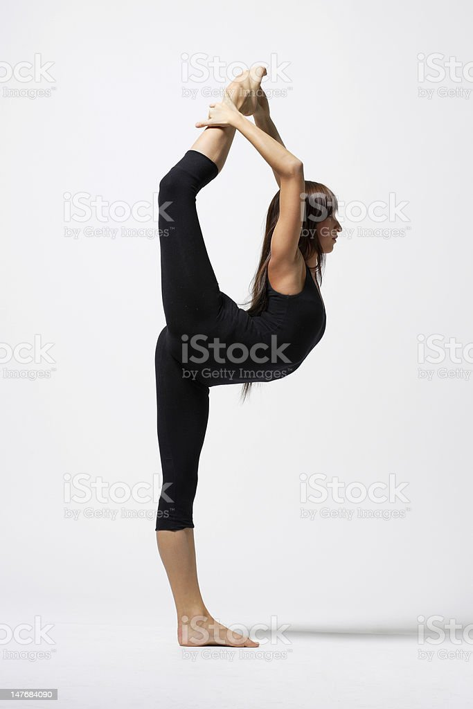 Flexible female dancer in a black outfit royalty-free stock photo