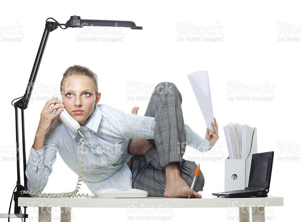 Flexible woman in office stock photo