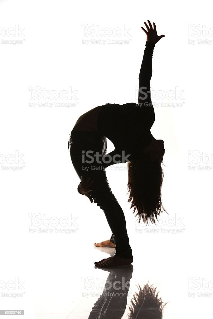 Flexible woman stretching silhouette royalty-free stock photo