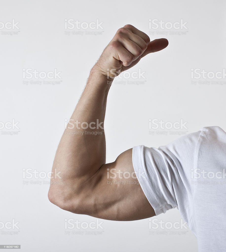 flexing male bicept in white t-shirt royalty-free stock photo
