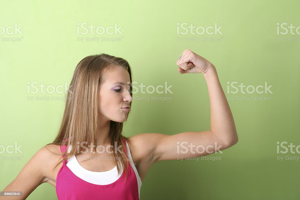 flexing muscles stock photo
