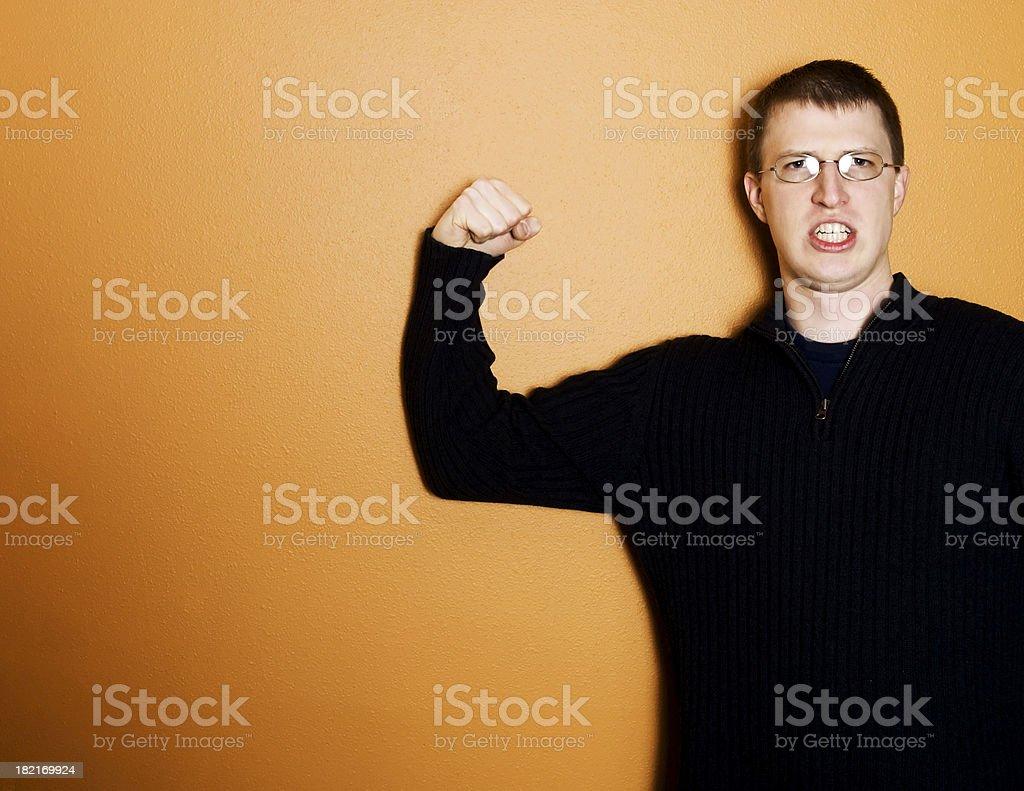 Flexing on orange royalty-free stock photo