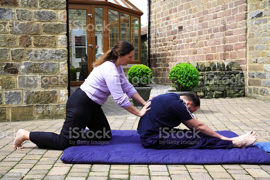 Flexing the spine 0- traditional Thai Body Massage royalty-free stock photo
