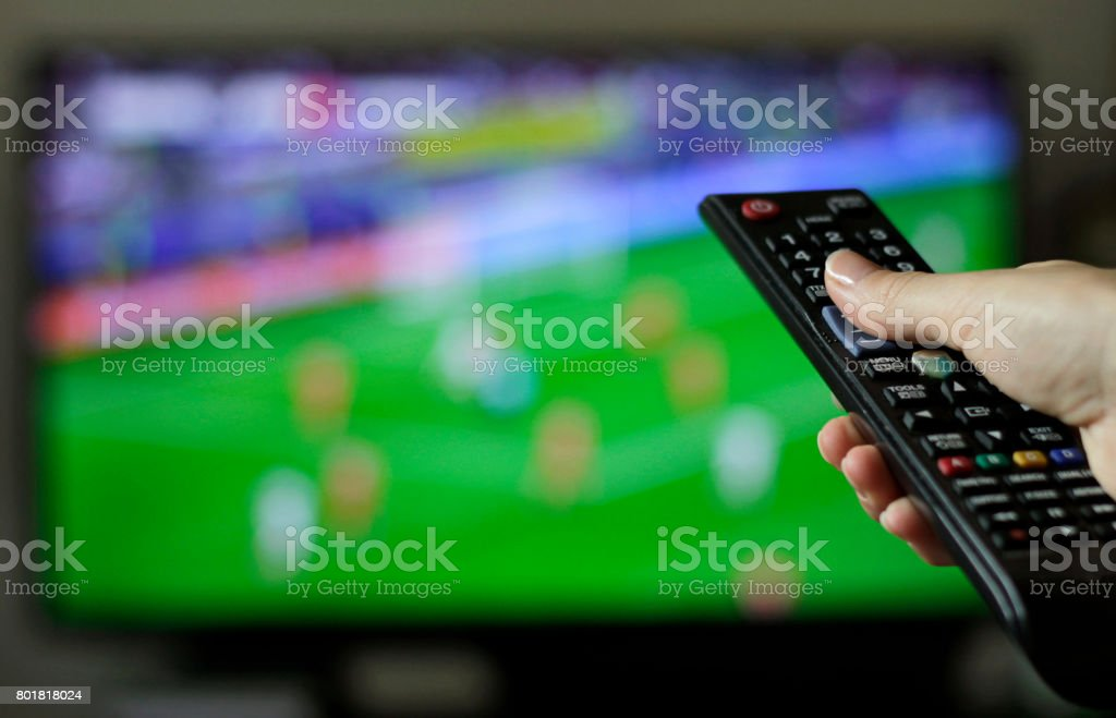 Flicking channels stock photo