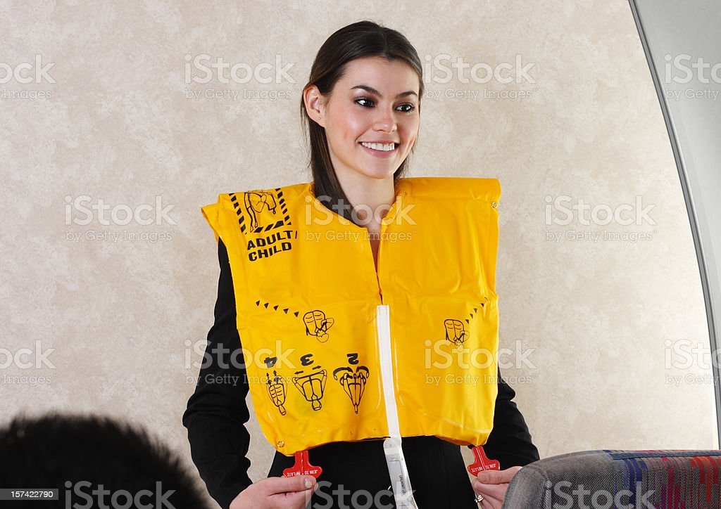 Flight Attendant Demonstrating Life Vest royalty-free stock photo