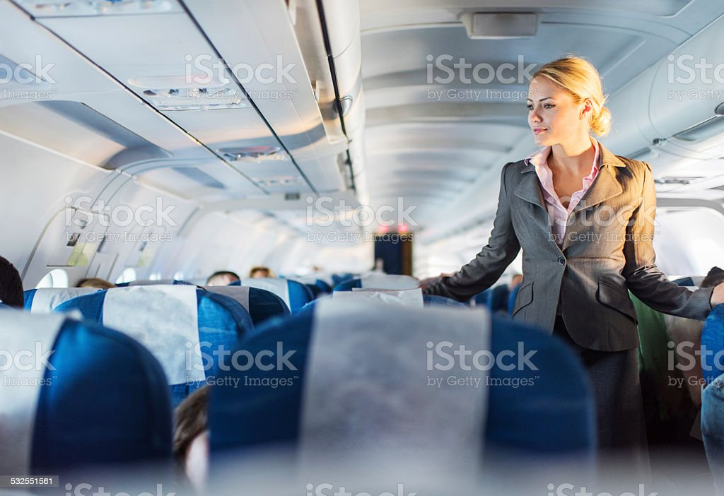 Flight attendant on duty. stock photo