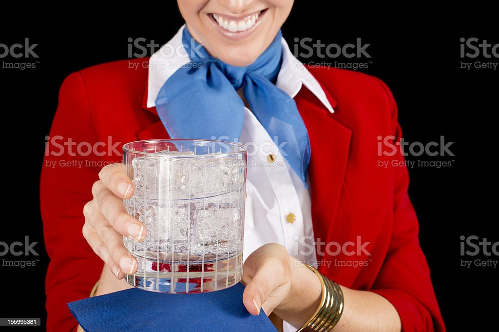 Flight Attendant Serving a Drink royalty-free stock photo