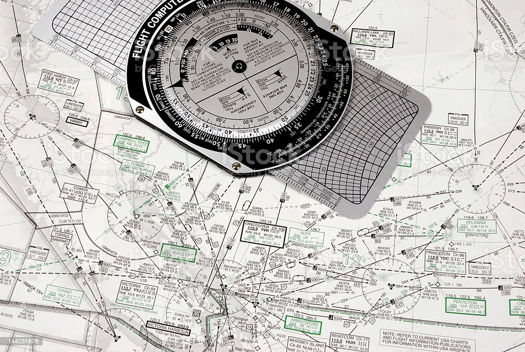 Flight compass over an aeronautical map stock photo