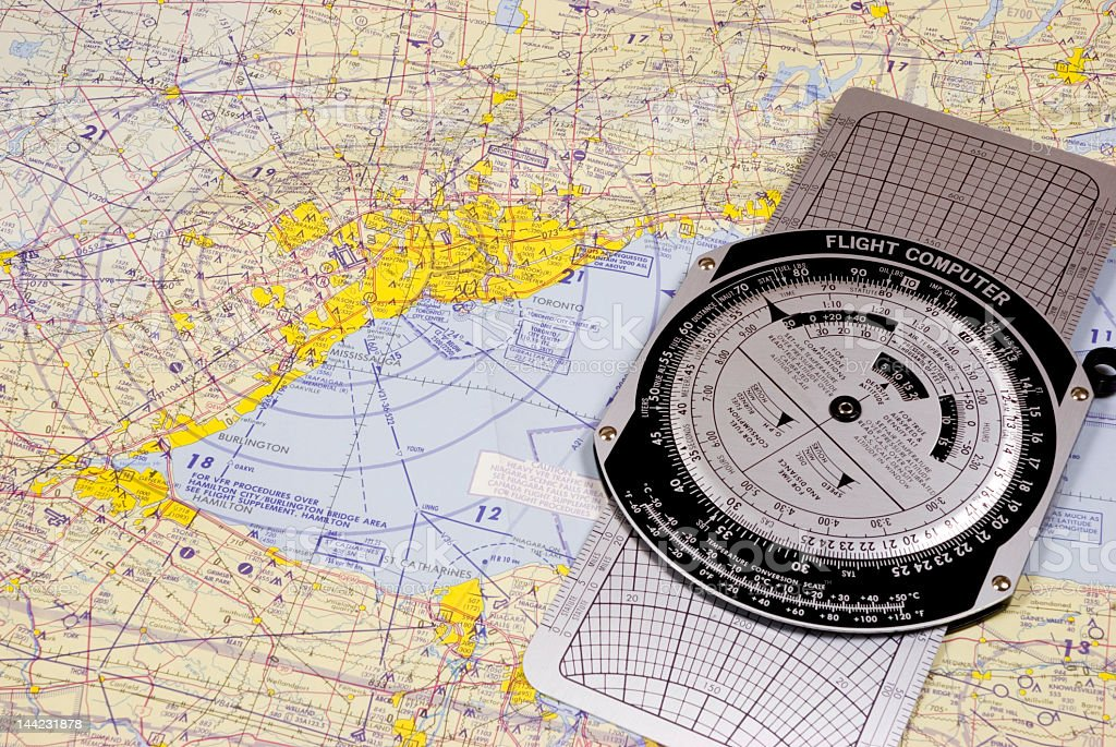 Flight Computer and Aeronautical Chart stock photo