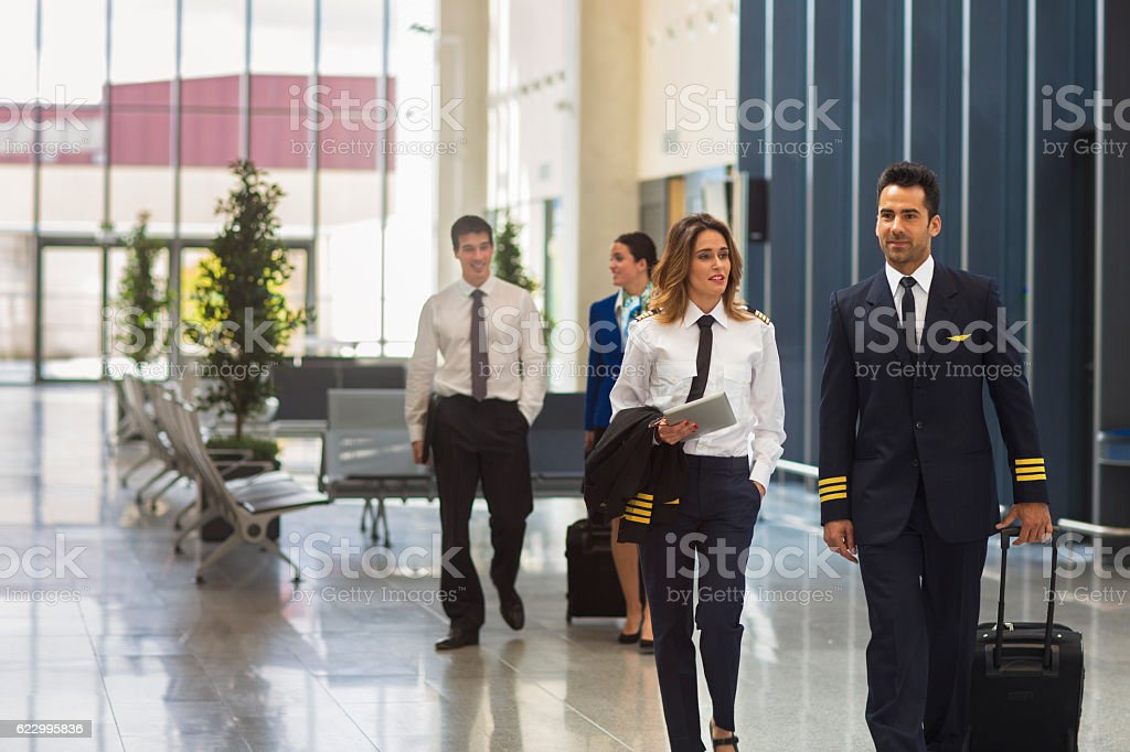 Flight crew preparing to go to airplane stock photo