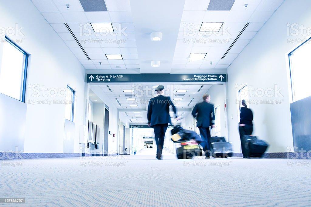 Flight crew walking through Raleigh (RDU) Airport royalty-free stock photo
