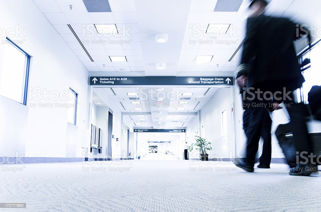 Flight crew walking through Raleigh (RDU) Airport royalty-free stock photo