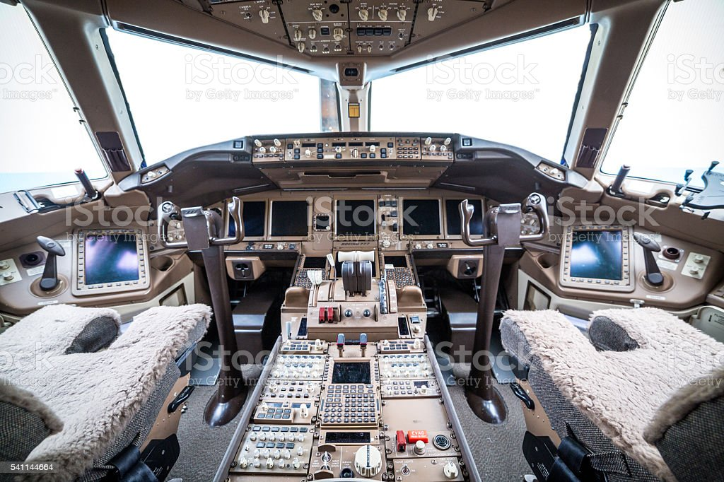 Flight deck in regular airplane stock photo