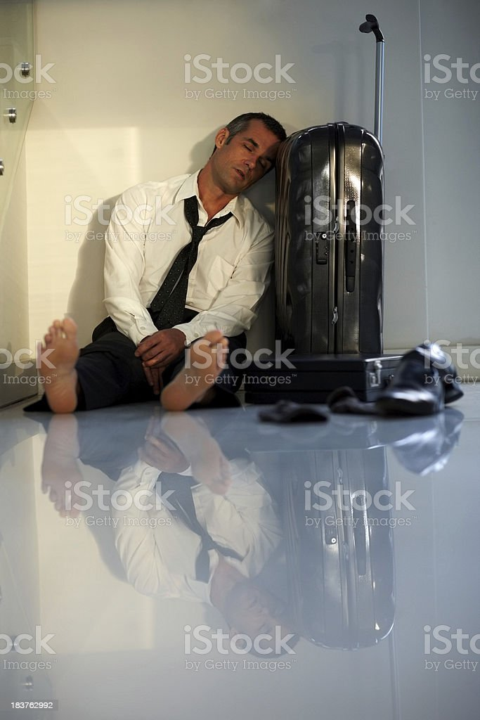 Flight delay - Tired businessman sleeping in the airport royalty-free stock photo