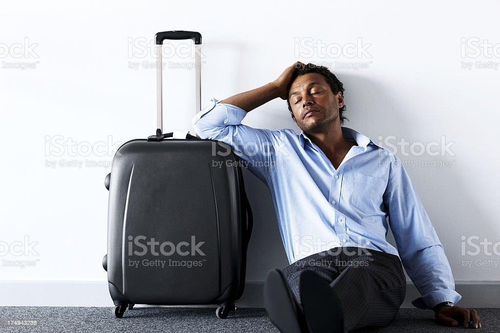 Flight delayed - Man sleeping at airport lounge royalty-free stock photo
