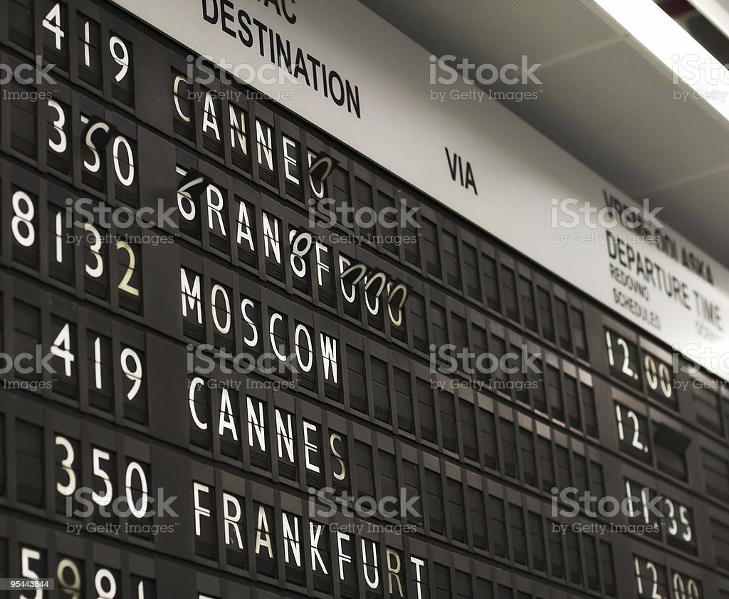Flight info board on airport royalty-free stock photo