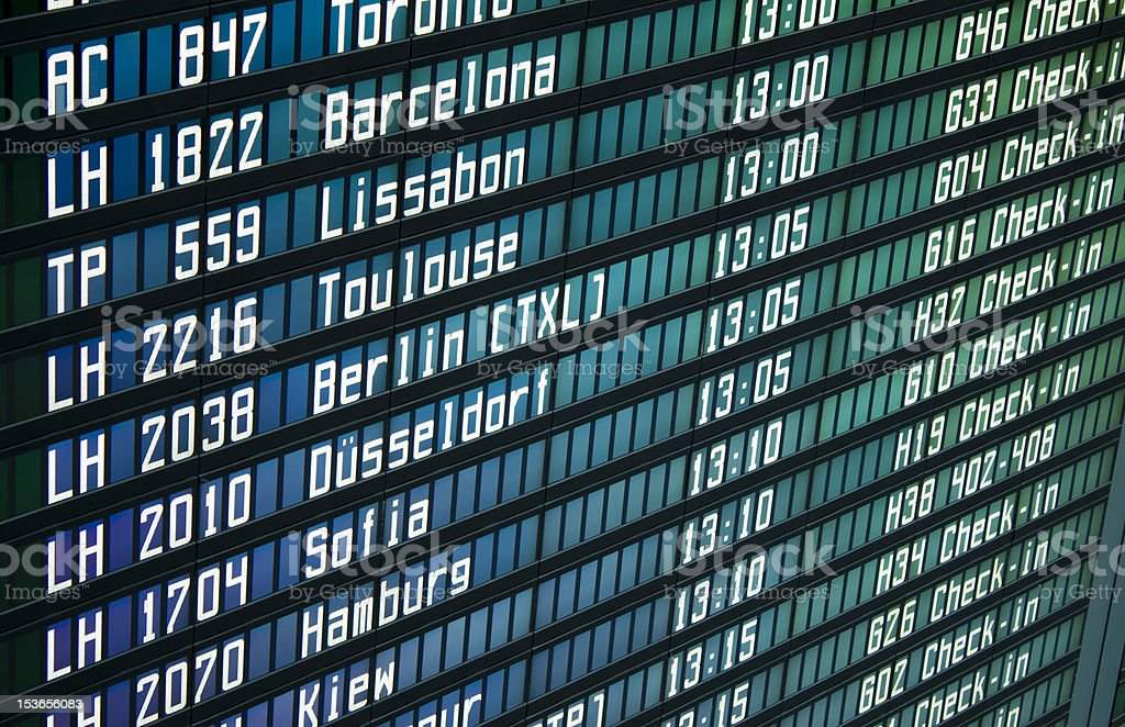 Flight information board in airport stock photo
