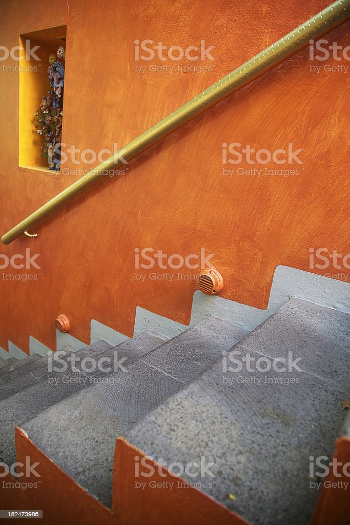 Flight Of Concrete Steps, Looking Down, Orange Stucco Wall, Mexico royalty-free stock photo
