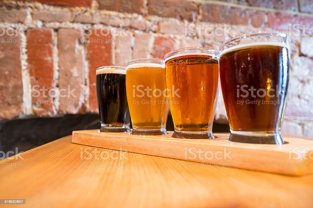 Flight of Four Beers for Tasting stock photo