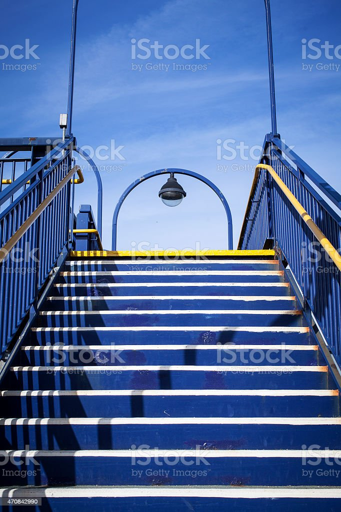 Flight of stairs leading up to the exit stock photo