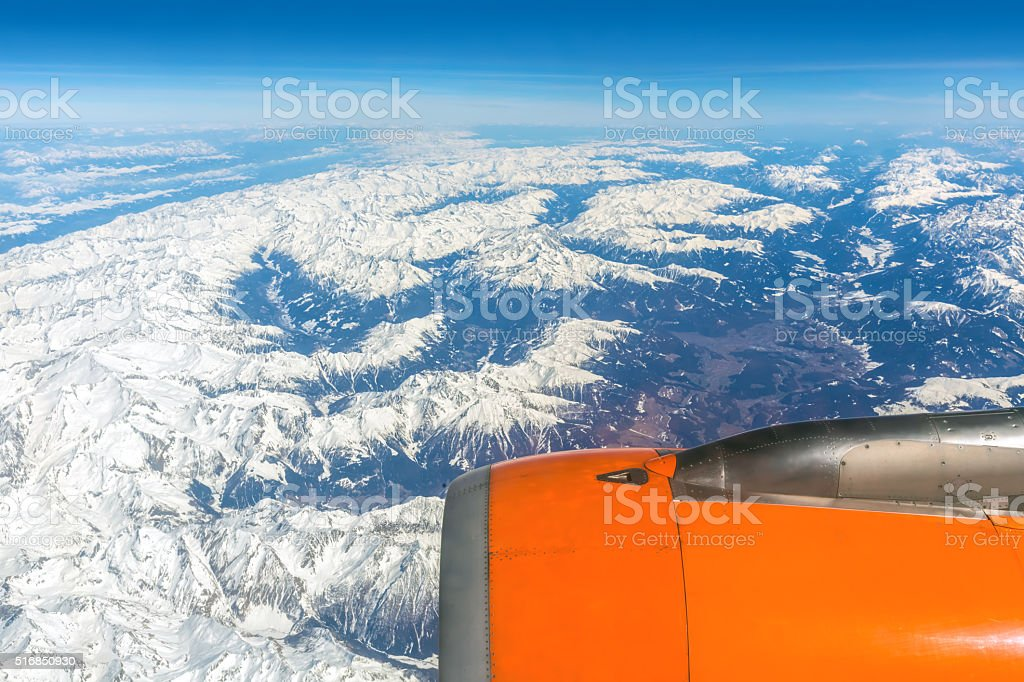 Flight over the Alps on a beautiful day stock photo