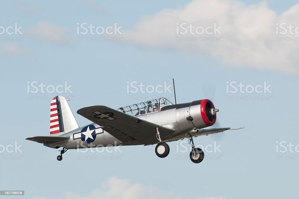 WWII flight trainer airplane Vultee BT13 flying stock photo