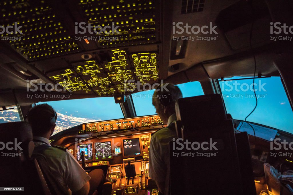 Flightdeck View of departing Boeing 777 stock photo
