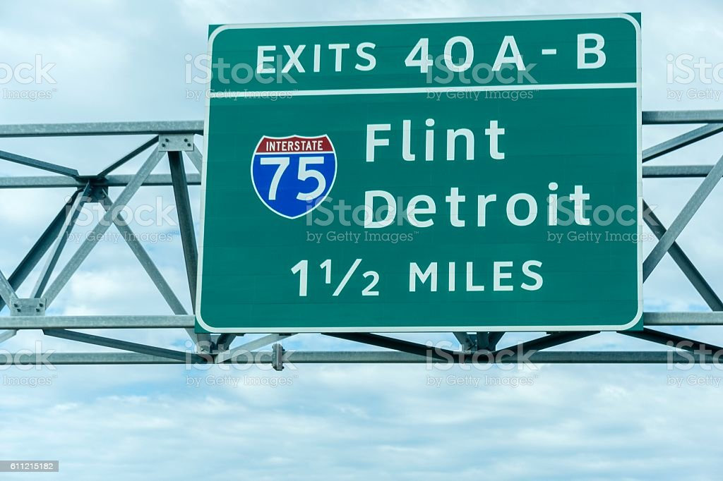 Flint and Detroit Michigan Exit Sign stock photo