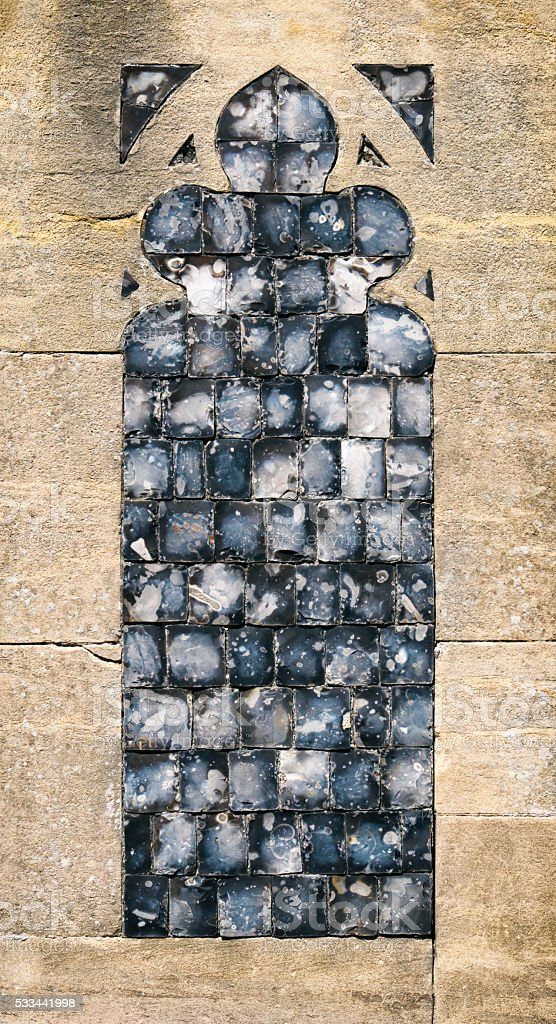 Flint detail on a church wall stock photo