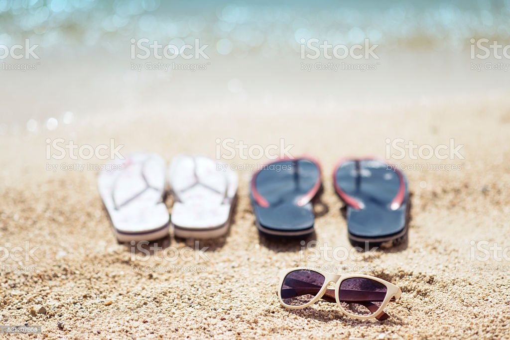 Flip Flop and Sunglasses on Summer Beach by the Sea stock photo