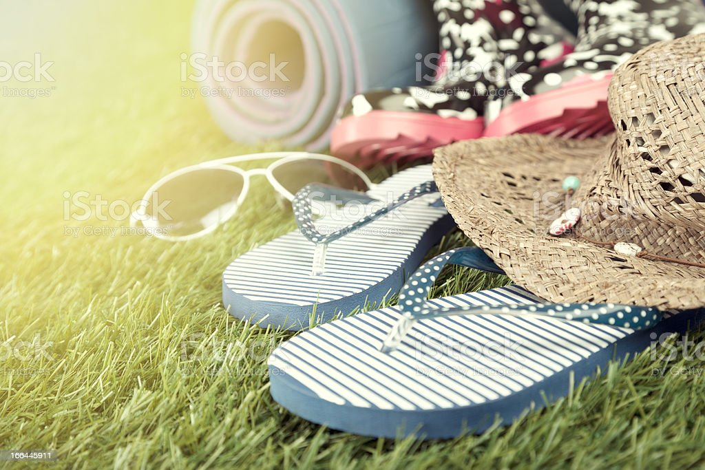 Flip flops and other items for music festival royalty-free stock photo