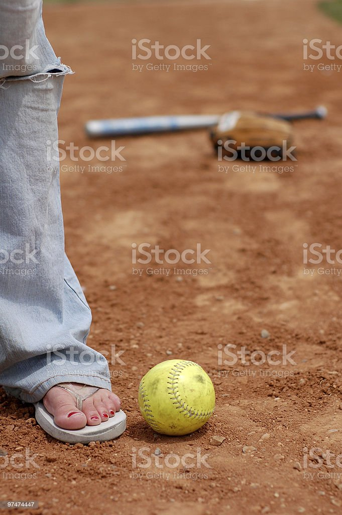 Flip Flops and Softball (close up) royalty-free stock photo