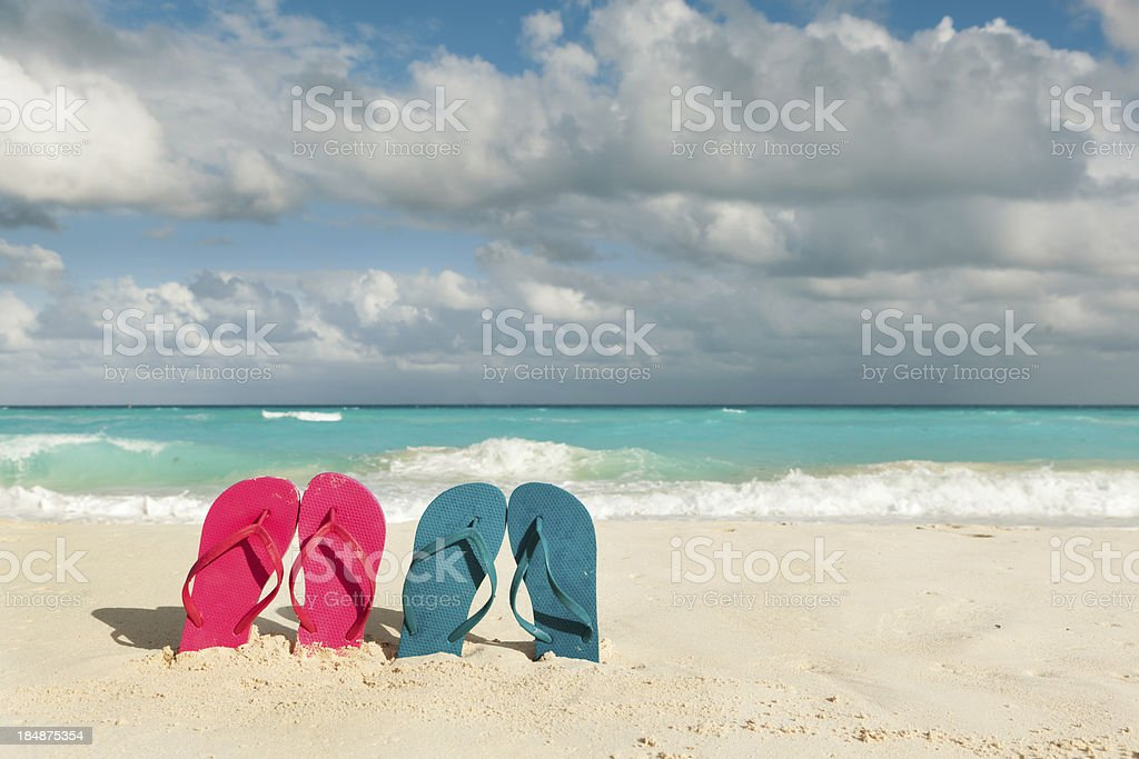 Flip Flops Couple Vacationing on Tropical Caribbean White Sand Beach royalty-free stock photo